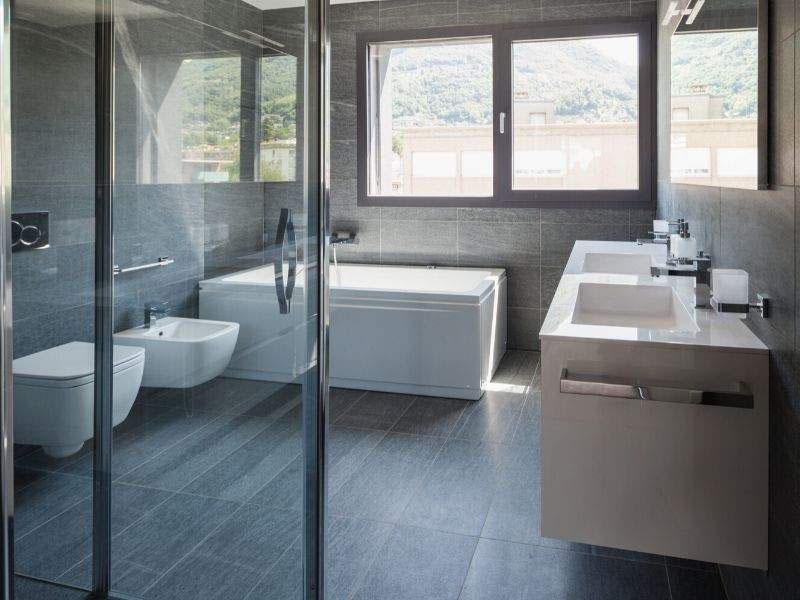 bathroom with black tiles